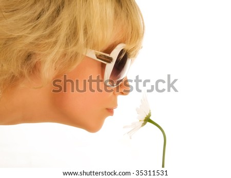 Smelling a flower - stock photo