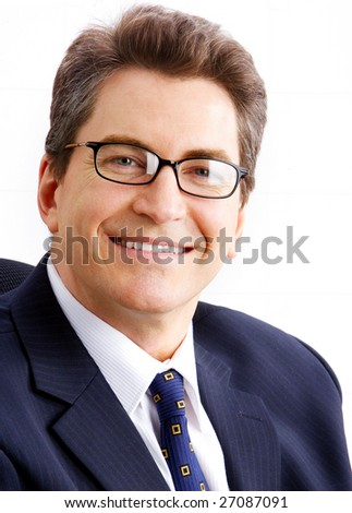 Smiling businessman. Isolated over white background - stock photo