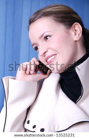.smiling businesswoman talking by cellphone