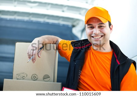 Smiling delivery boy portrait - stock photo