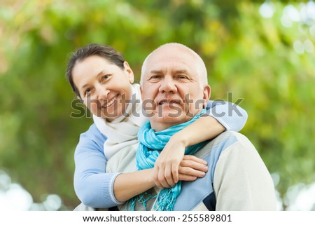 smiling mature couple in sweaters  - stock photo