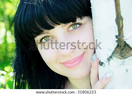 smiling young woman with a birch