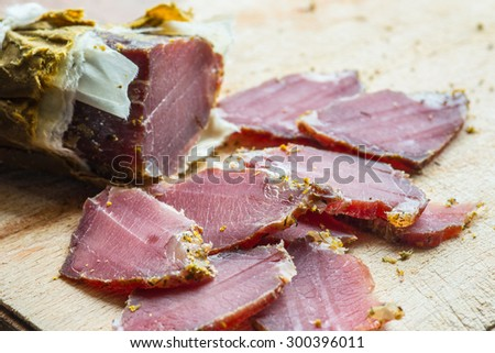 smoked wild boar meat on the wooden board  - stock photo