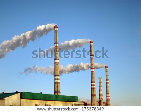 Smoking pipes of factory                               - stock photo