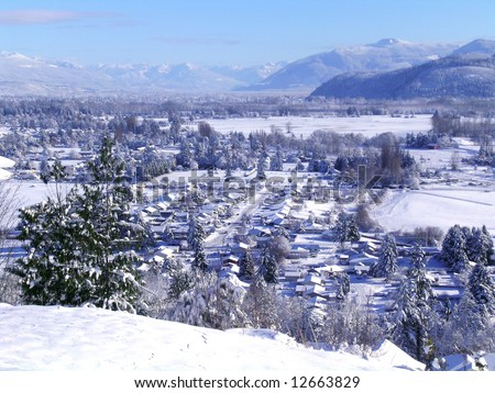 Snow-Covered Village - stock photo