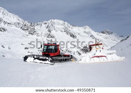"""Snowcat"" in the Alps - stock photo"