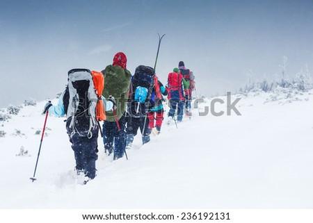 snowshoeing in winter Carpathian mountains - stock photo