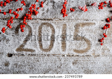 2015. snowy wooden background  - stock photo