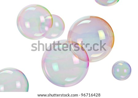 Soap bubbles over white background - stock photo