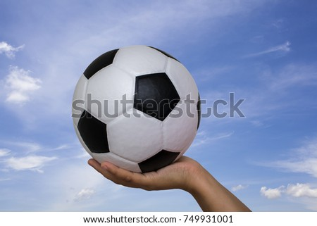 Soccer ball against the backdrop of the sky
