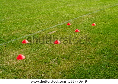 Soccer football training cones for marking on the field grass                               - stock photo