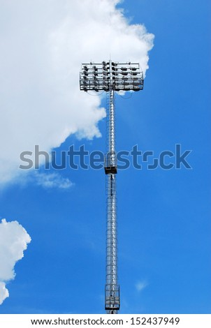 Soccer game spotlight on daylight background - stock photo