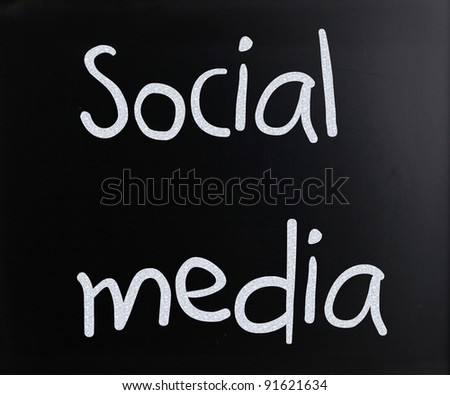"""Social media"" handwritten with white chalk on a blackboard - stock photo"