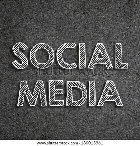 """""""Social media"""" written on a chalkboard - stock photo"""