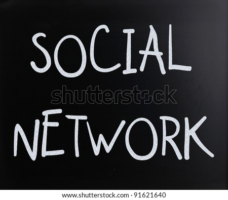 """Social network"" handwritten with white chalk on a blackboard - stock photo"