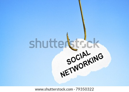 'Social networking' on a fishing hook in front of blue computer monitor. Conceptual image about risk of addiction to social networking.