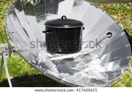 solar cooker with reflective panels make to cheap materials ,  renewable green energy - stock photo