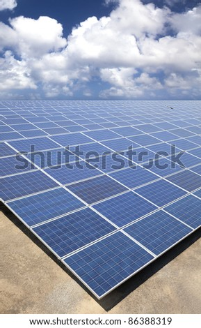 Solar Panels with cloud sky background - stock photo