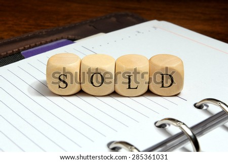 Sold word concept on notebook