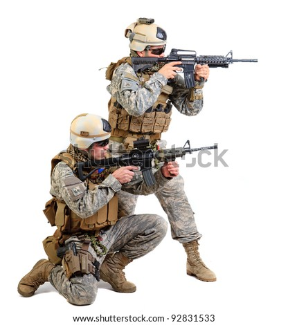 soldier with a rifle isolated on black background - stock photo