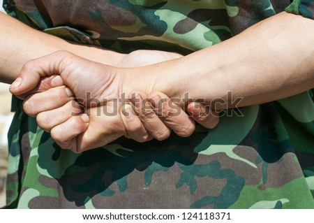 soldier with Hands, behind. - stock photo