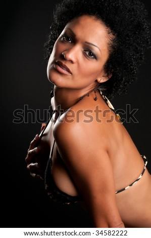 30 Something very sensual hispanic brunette woman in bikini. - stock photo
