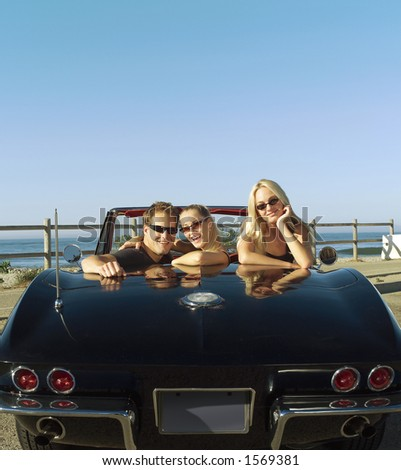 20 somethings in convertible - stock photo