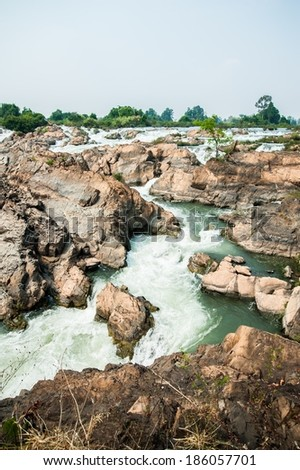 Somphamit waterfall from Mekong River in Champasak Province, Laos, Si Phan Don (four thousand islands)   - stock photo