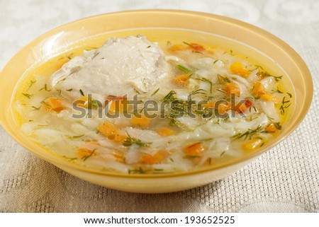 Soup of chicken breasts with vegetables cabbage, potatoes, carrots, onions, dill.