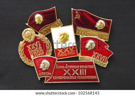 Soviet badges with Lenin on dark background - stock photo