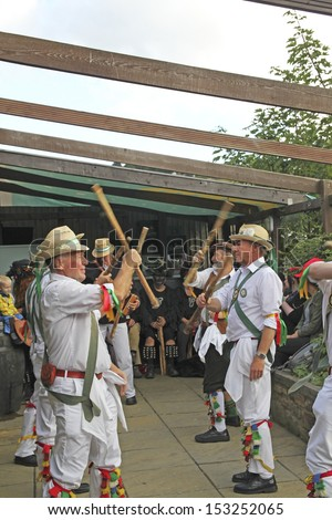 """SOWERBY BRIDGE, UK - SEPT 7 2013: Unidentified players of the Morris Men performing  their traditional dance style at the 37th Annual Sowerby Bridge Rushbearing Festival, 7 September 2013."