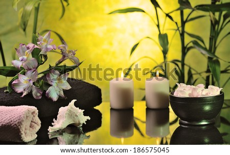 spa still life with bamboo on glowing yellow background  - stock photo