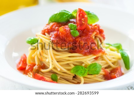 Spaghetti with tomato, chilli and basil leaves