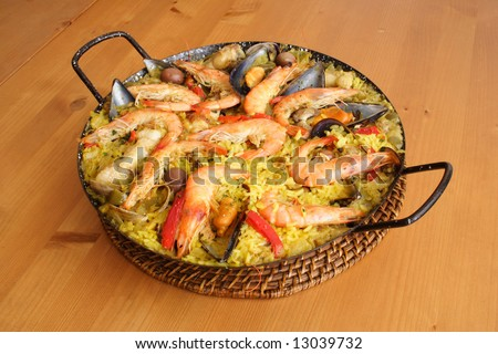 Spanish paella on the table ready to eat - stock photo