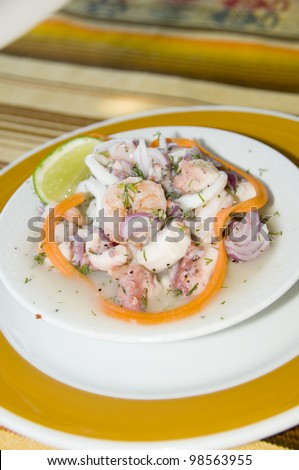 Spanish seafood salad appetizer tapas shrimp octopus caracol conch photographed in San Luis San Andres Island Colombia salpicon de mariscos - stock photo