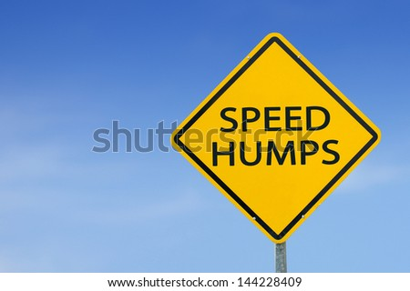 """""""SPEED HUMPS"""" traffic sign with blue sky - stock photo"""