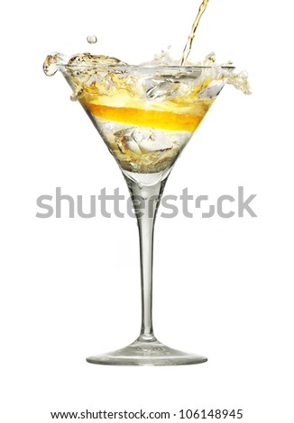 Splashing of alcoholic beverage in wineglass with lemon and ice isolated on white. - stock photo