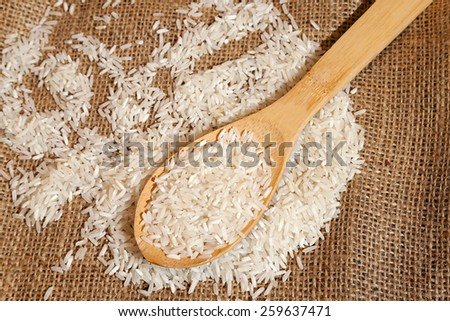 spoon scattered grains of rice. Close-up. - stock photo