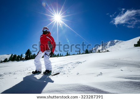 Sport man in snow mountains in background beautiful sky  - stock photo