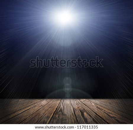 Spot lighting over dark background and wood floor. concert - stock photo