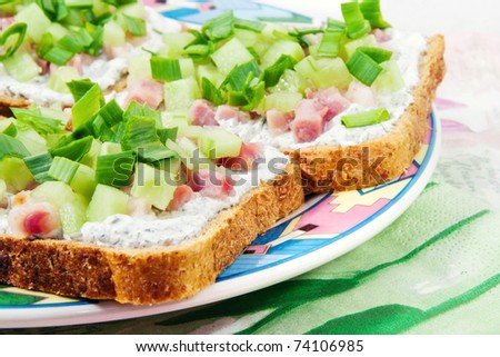 Spring snacks - light open faced sandwiches with cream cheese & veggies (shallow dof) - stock photo