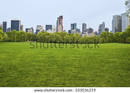 """Spring View Sheep Meadow"" The huge lawn of Sheep Meadow in Central Park on a quiet Spring Day in Manhattan. - stock photo"