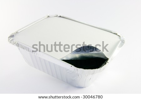 1 square foil partly opened catering tray - stock photo