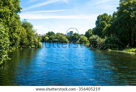 St. James's Park Lake in with The London Eye on background. London. UK - stock photo