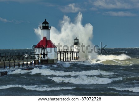 St. Joseph Lighthouse ,St. Joseph Michigan USA Sun shining on outer Lighthouse - stock photo