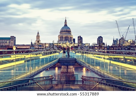 St Paul's Cathedral and Millennium Bridge at night. - stock photo