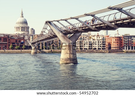 St. Paul's Cathedral and Millennium Bridge at summer. - stock photo