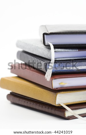 Stack of notebooks close up ,shallow dof