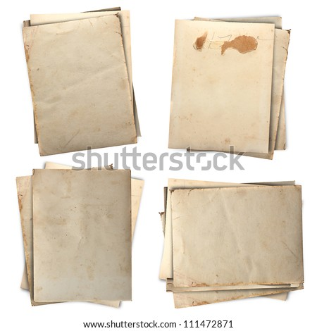 stack of old papers set isolated on white background with clipping path - stock photo
