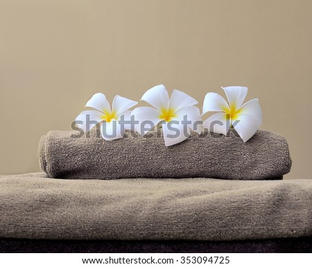 stack of towels with frangipani flowers - stock photo